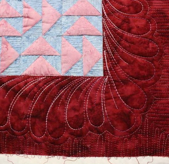 Quilting inside the feathers with finer thread adds more visual interest and texture.