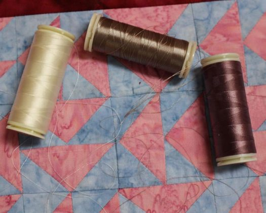 A selection of WonderFil InvisaFil thread to use for quilting.
