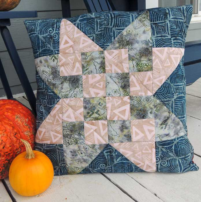 Checkerboard star quilted cushion cover made with Rock City batiks.