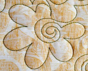 Rounded flower with spiral center machine quilting design