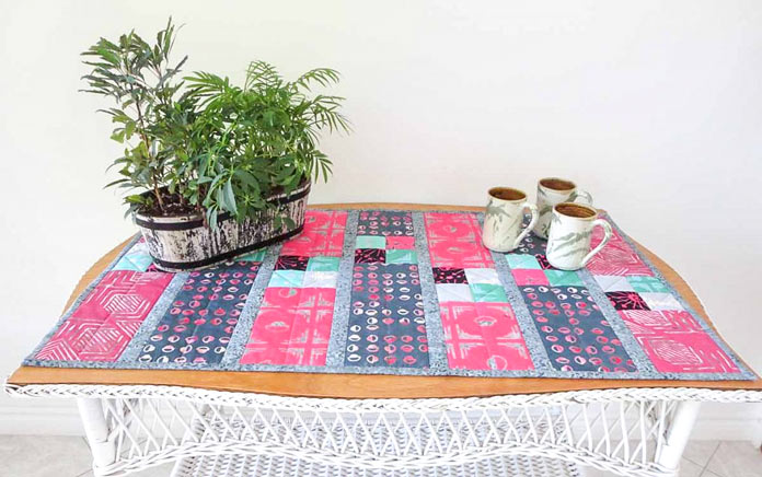 Finished table runner made with Banyan Batiks Tie one On fat quarters