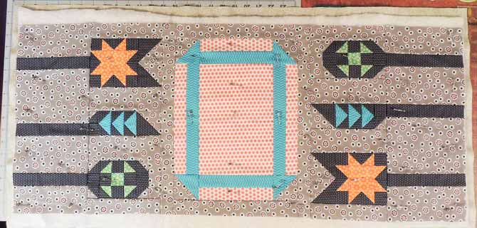 layered and pinned runner prepared for quilting