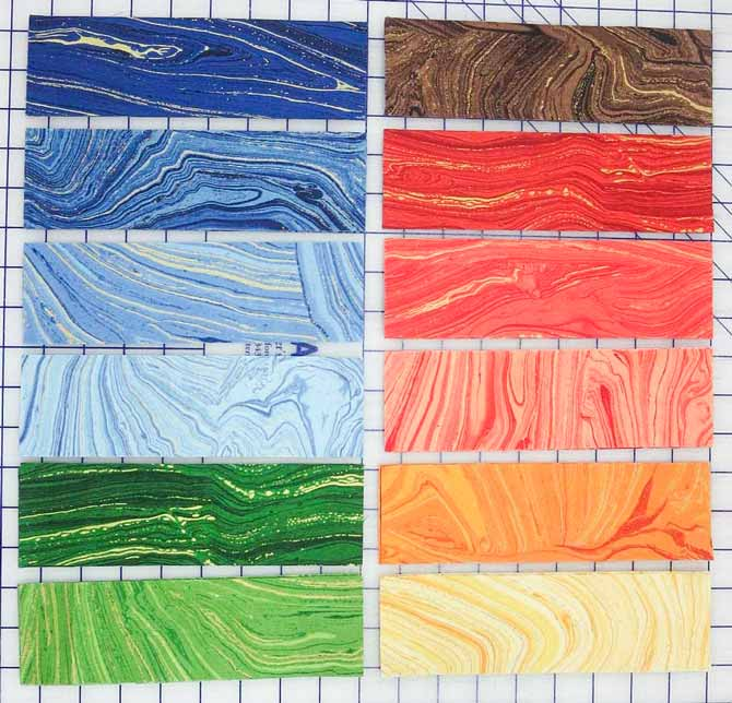 "2½"" x 8½"" strips cut from 12 different Sandscapes fabrics for the side borders"