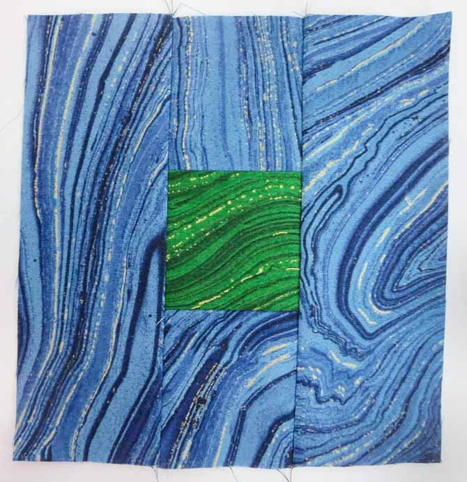 "6½"" x 6½"" finished block using Sandscapes green in the center and Sandscapes blue on the outside of the block"