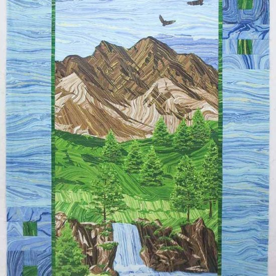 """""""Mountain Peak"""" panel quilt with pieced border using Northcott's Sandscapes fabrics. Finished size 35"""" x 55"""""""