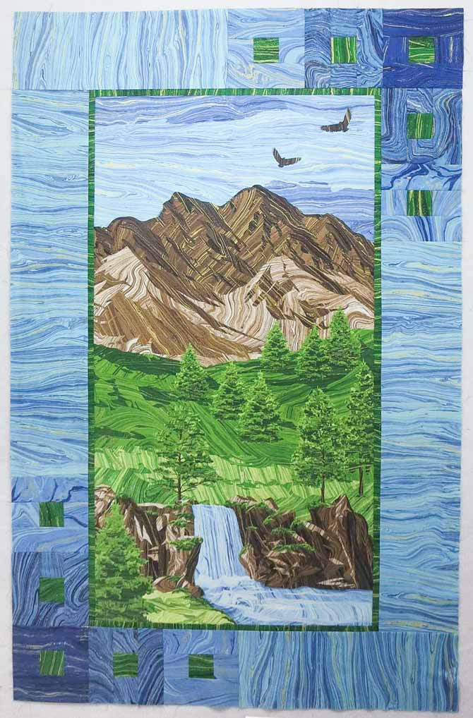 """Mountain Peak"" panel quilt with pieced border using Northcott's Sandscapes fabrics. Finished size 35"" x 55"""