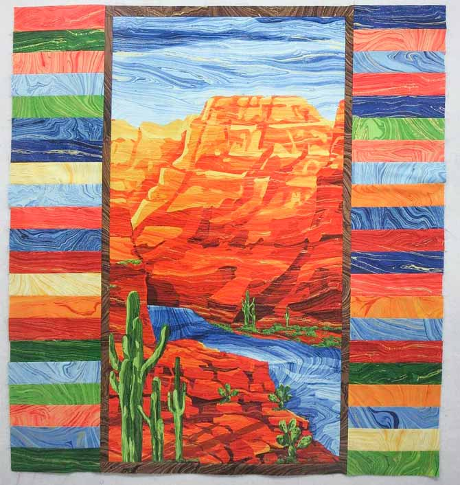 Side borders sewn to the panel Artisan Spirit Sandscapes fabrics and quilt panel