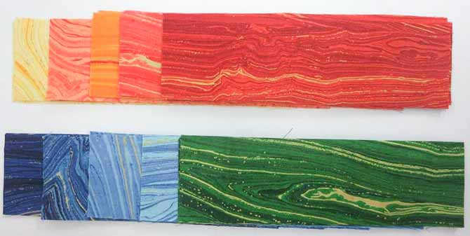 """2½"""" x 8½"""" strips from Northcott's Sandscapes collection for the outer side borders"""