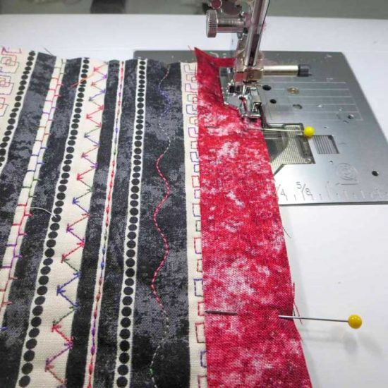 """Sew sashing strips to the front and back of a 6½"""" square."""