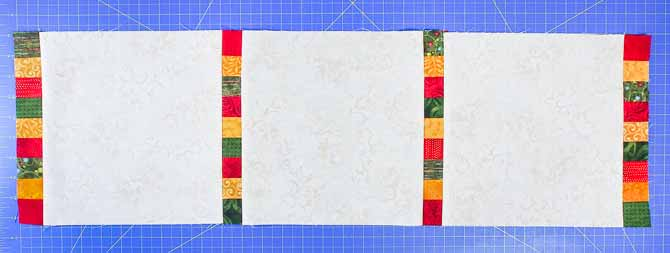 4 sashing units of red/green/gold fabrics and 3 cream blocks sewn together to create the center of the Christmas runner