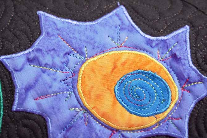 Satin stitched applique with WonderFil's Splendor rayon thread.