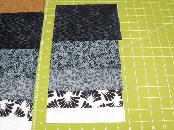 With fabrics as beautiful as the Banyan Batiks Banyan Classics Collection, you won't want to waste a scrap! Turn the leftovers into a fun and free bonus project! Free rail fence quilt pattern