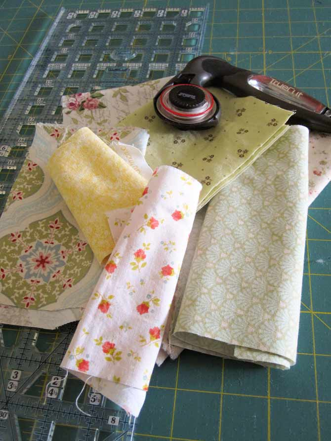 "Collect your pretty scraps and cut them into 2"" wide strips of varying lengths."