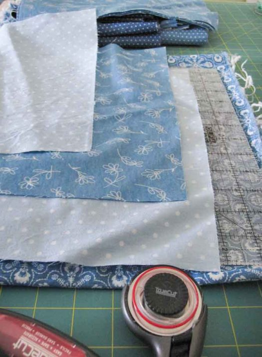 "Use a 12½"" square ruler to cut several blocks of coordinating background fabrics -- in this case -- breezy casual chambray."