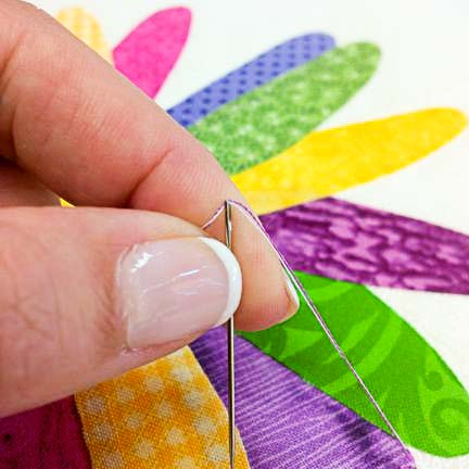 Pop the threads through the opening of a self-threading needle