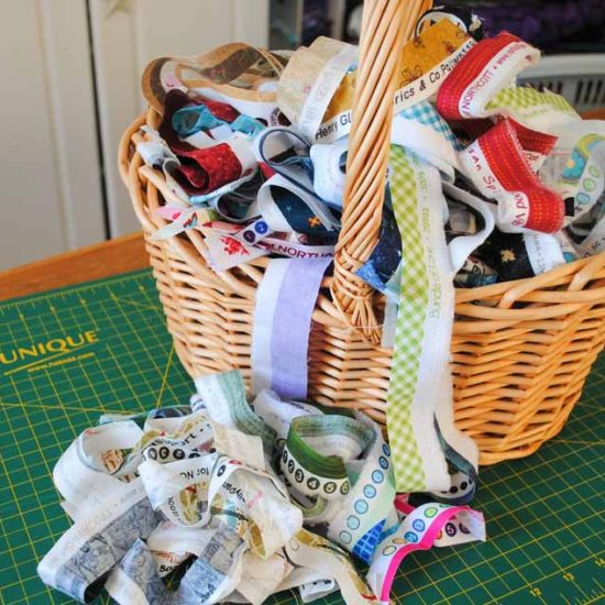 A basket of selvages will be used to make a fabric panel with the Brother NQ900 sewing machine.
