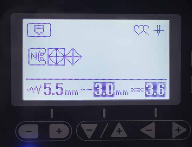 The height of the stitch is adjusted using the +/- buttons on the LCD screen of the NQ900.