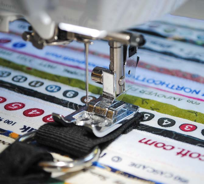 The handle tabs are sewn to the bag with the sideways stitching feature of the NQ900.