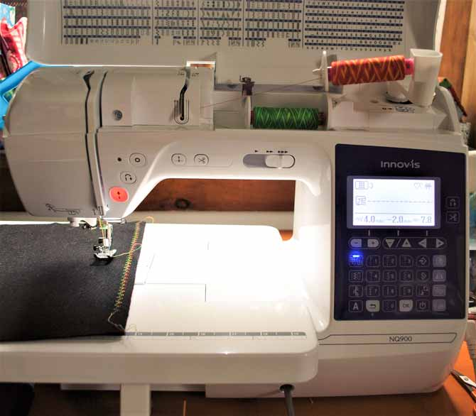 The NQ900 sewing machine is all set up for twin needle stitching.