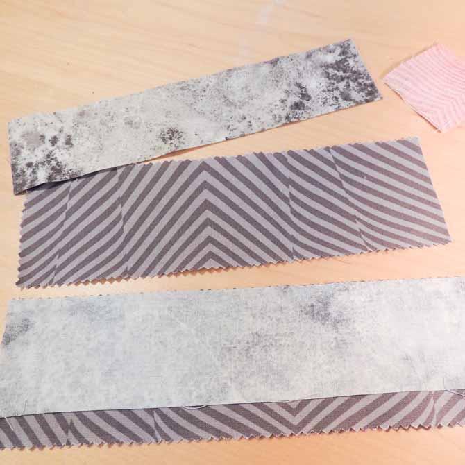 Sew longest grey strips together