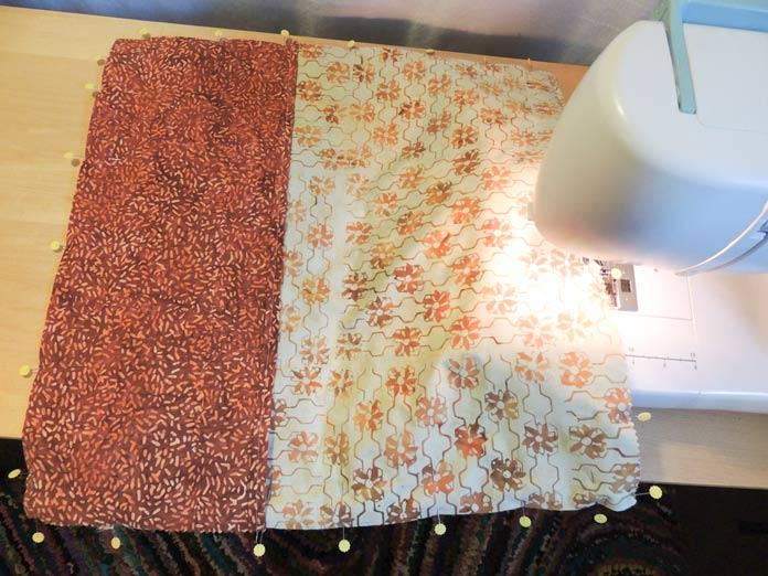 Sewing around the layered cushion panels.