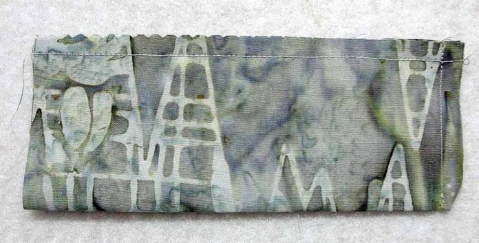 Stitch on 2 sides of the pincushion fabric.