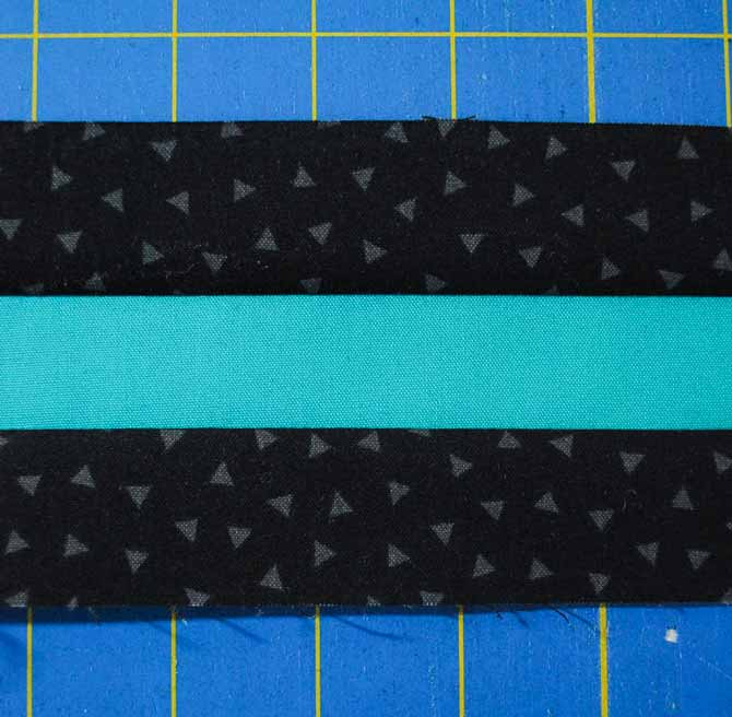 Sewing the teal and black strips together