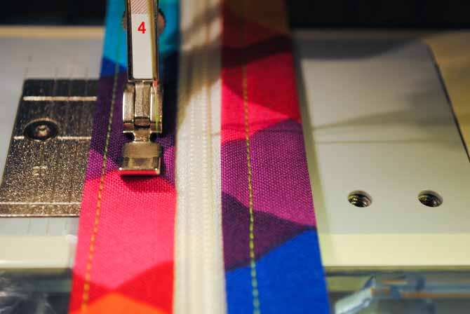 Sewing the zipper to the top of the vinyl pocket