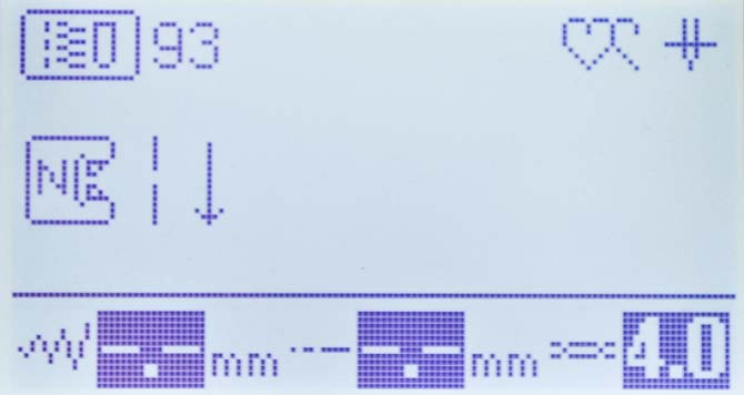 The LCD screen of the NQ900 showing the settings and required foot for sideways stitching.