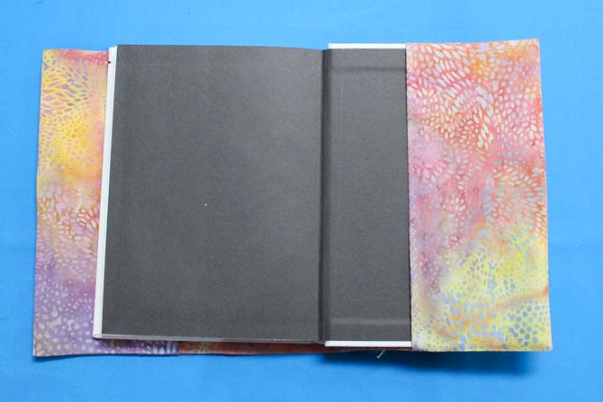 Turn the cover right side out, press and then slip the front and back journal covers into flaps.