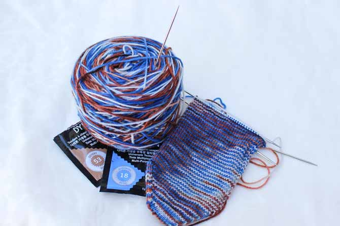 I've dyed wool sock yarn with Dylon Multi-Purpose Dyes in Desert Dust and Madonna Blue to create a variegated yarn