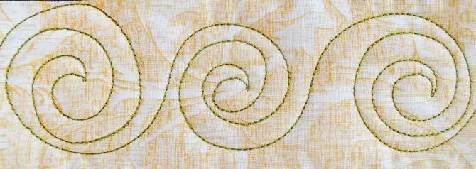 Spirals border design with Spagetti thread from WonderFil