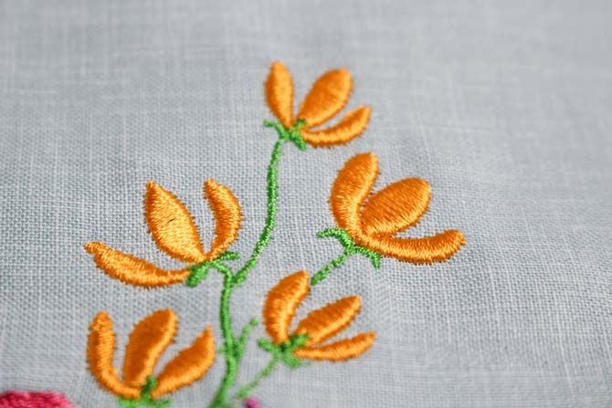 Yellow flowers machine embroidery stitched with WonderFil's Splendor rayon thread.