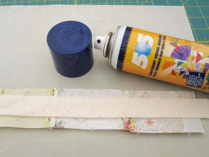 Spray baste the batting to the center of the pieced patchwork, using an applique sheet to protect the table surface.