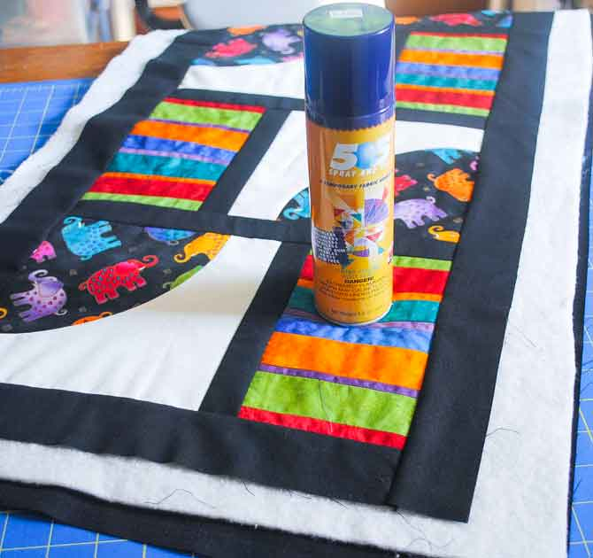 Spray basting the quilt sandwich
