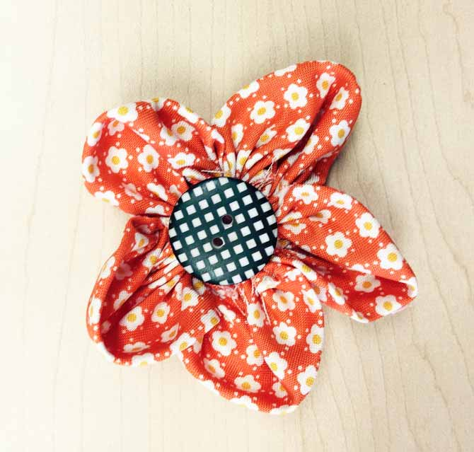Fabric flower made from fabric squares.