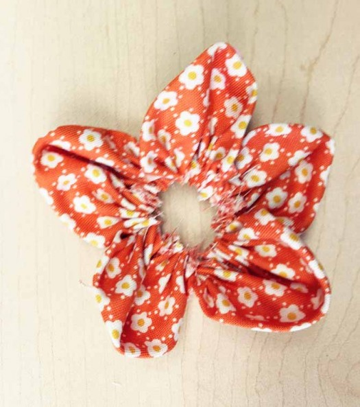 5 petals stitched together to create a fabric flower.