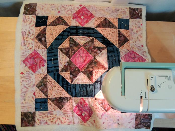 Overhead view of quilting cushion cover front.