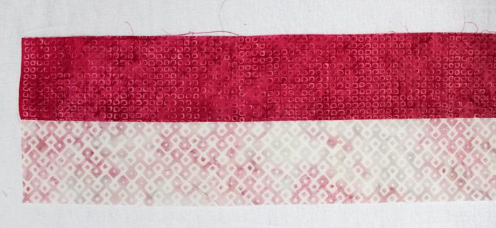 "Stitch together the light D5 strip to the medium dark B4 strip. Cut to make four (4) 2½"" x 4½"" rectangles."