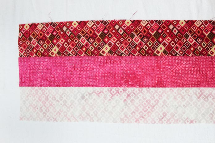 "With the leftover strip, stitch a dark strip (A3) along the medium dark strip. Cut to make four (4) 2½"" x6½"" rectangles."