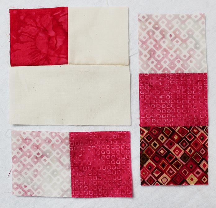 """Stitch a step 13 and step 14 rectangles to a Step 11 square. Makes a 6½"""" square. Repeat to make 4."""