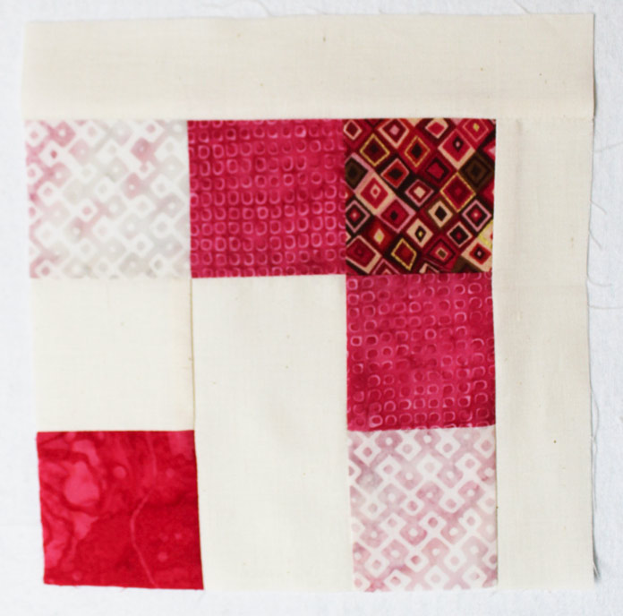 Stitch a R1 and R2 rectangles to a step 14 square.