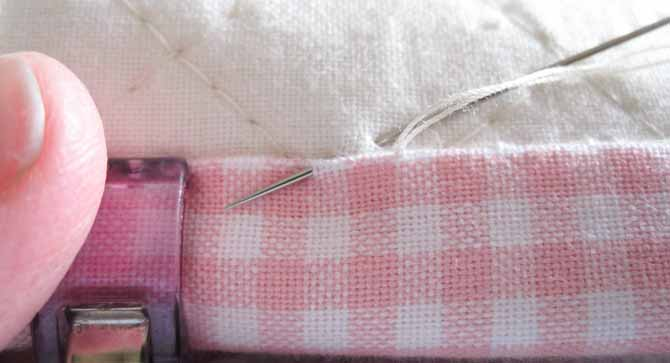 Slip stitch the binding to the back of the quilt.