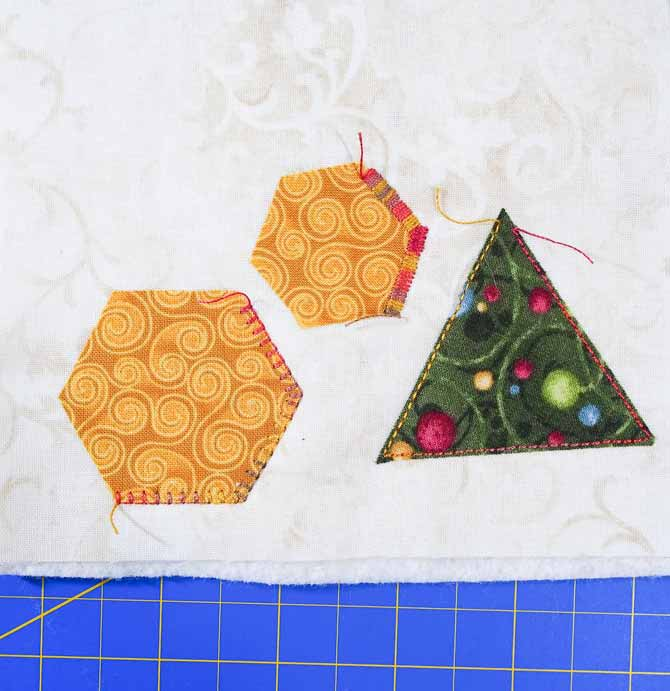 3 shapes with 3 different types of stitching in variegated thread
