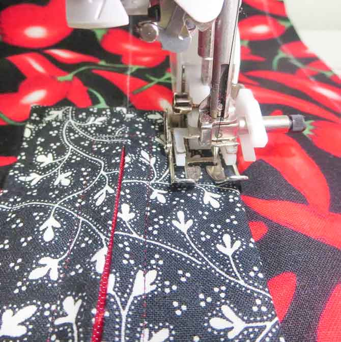 Quilting around the zipper embellishment with the walking foot