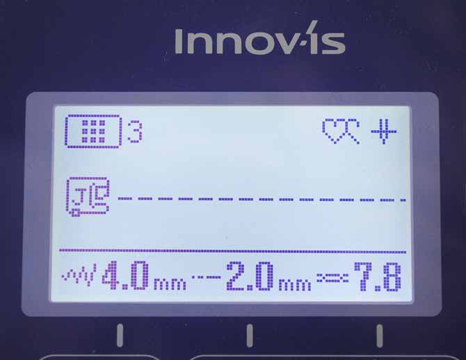 The LCD screen on the NQ900 showing the settings selected for stitching the selvages to the interfacing.