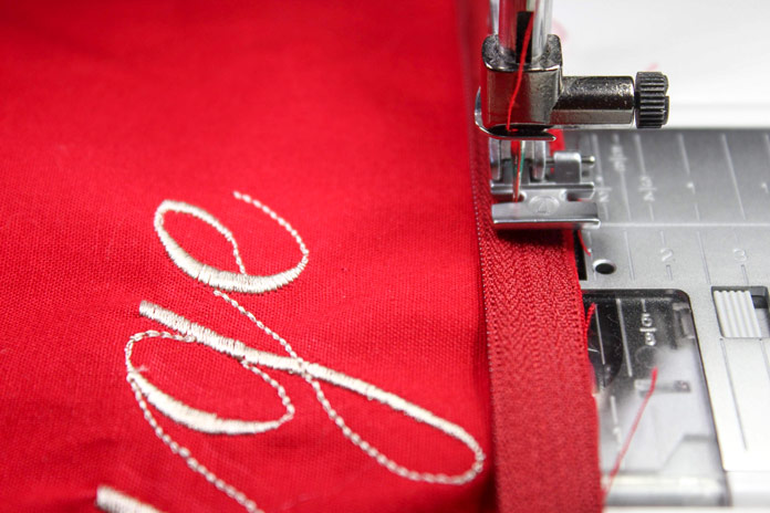 Using the zipper foot, stitch the zipper into place.