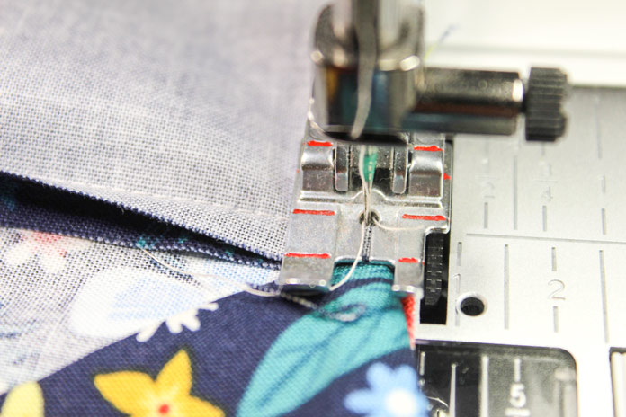 "The red line just in front of the needle hole is exactly at ¼"", which means that as soon as the edge of the fabric reaches that red line, you need to stop."