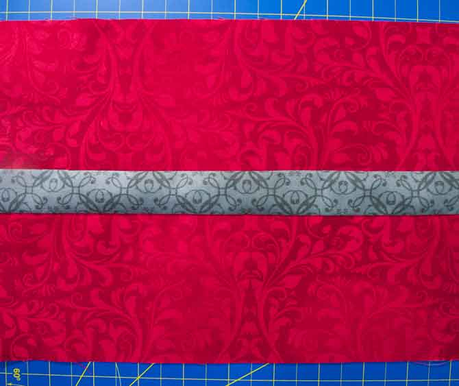 "8"" wide strip of gray and red fabric for the diamond template C"