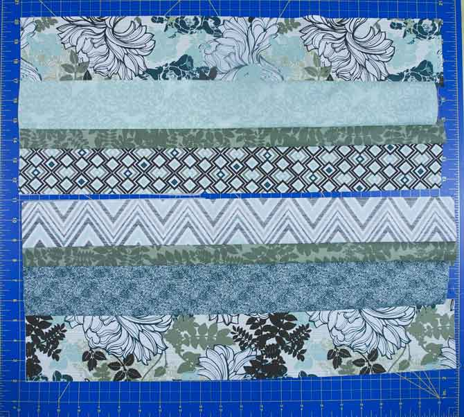 2 strip sets each made with 4 fabrics of varying widths from the feature fabrics